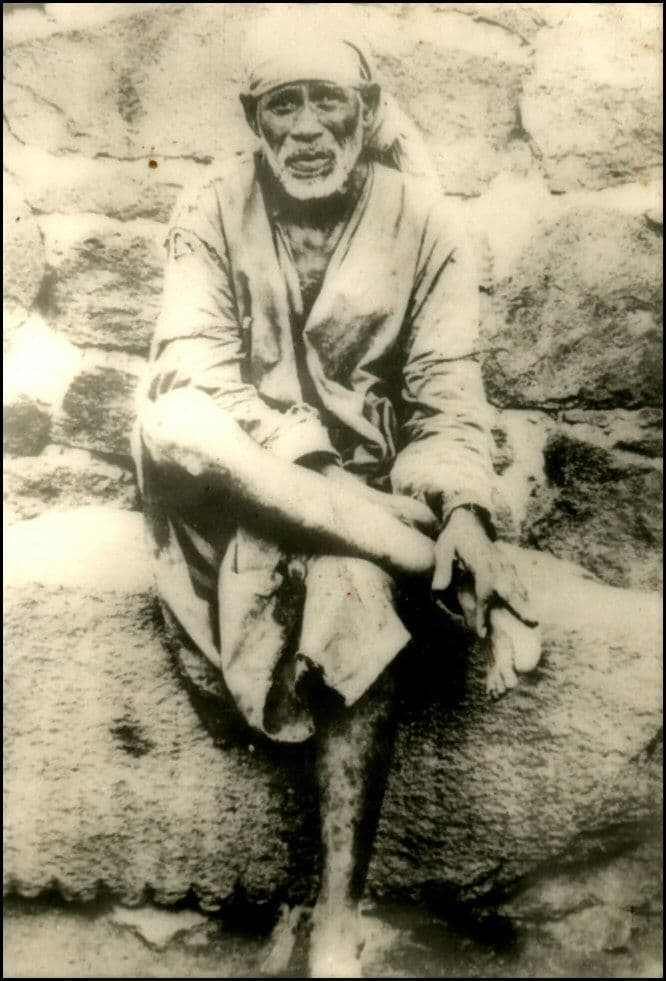 Shirdi Sai Baba seated on stone